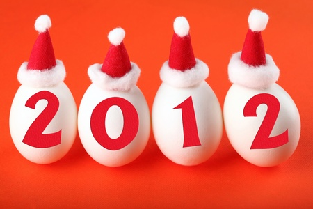 Birth of the new 2012 year: eggs in Santa photo