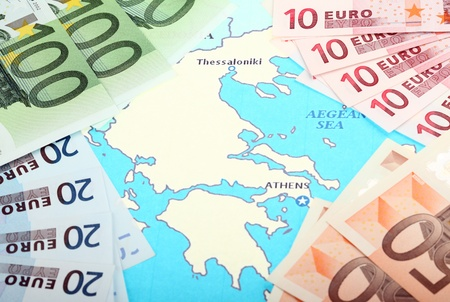 Europe helps Greece; euro banknotes on map of Europe around Greece