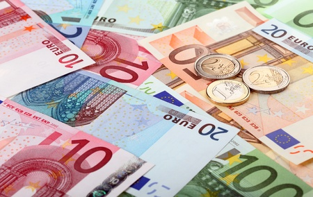 Different euro banknotes and coins Foto de archivo