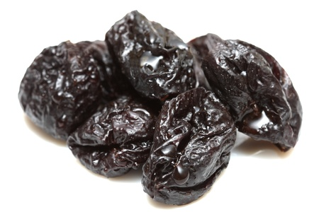 Handful of sweet prunes on white background