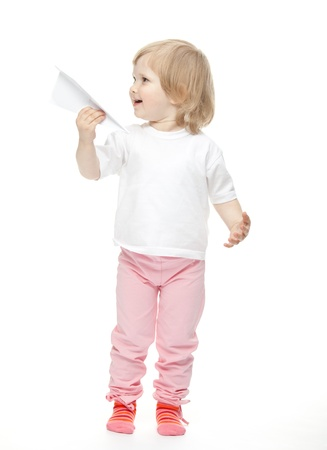 The baby girl is flying a paper planes on white background Stock Photo - 11474569