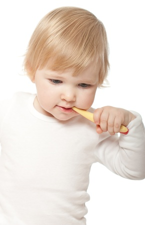 babies playing: The baby girl with a tooth-brush on white background Stock Photo
