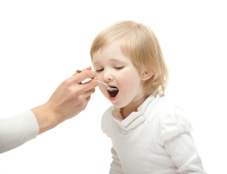 breackfast: The baby girl is eating vegetables puree