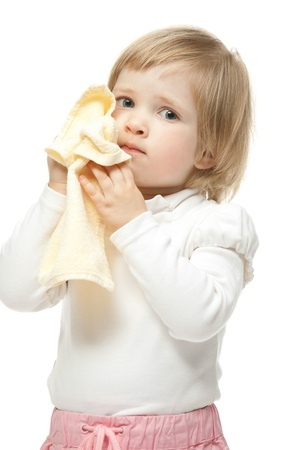 assiduously: The baby girl is wiping face; white background.