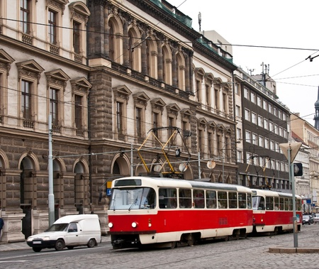 The old building and red tram in the Prague photo