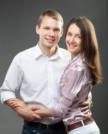 Portrait of smiling young couple on neutral background Stock Photo - 11771628