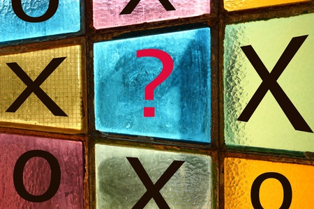 ques: Ouths and crosses: decisive move. Question mark in the last blank square Stock Photo