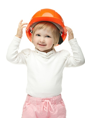 Smiling little girl dressed in orange helmet on white background photo