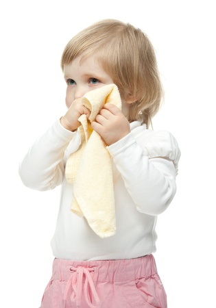 assiduously: The little girl wiping her face; white background