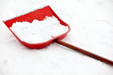 Shovel for snow removal with red  plastic scoop