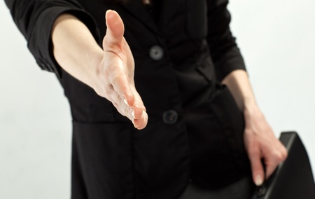 Businesswoman offering to shake hands to you photo