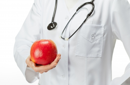 illustrating: Doctor proposing apple illustrating healthy eating (or diet)