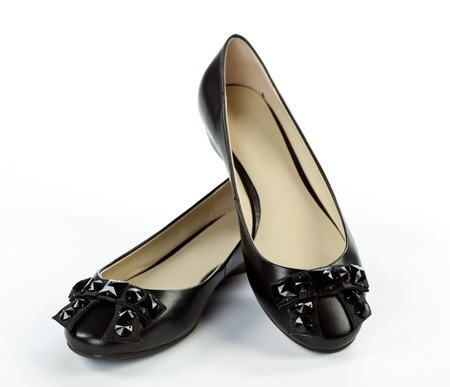 Pair of elegant flat shoes on white background