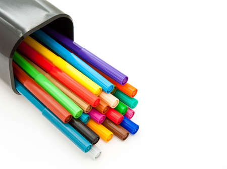 Diagonal fragment of closed colorful markers in the case pencil; white background photo