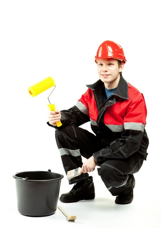 Cheerful construction worker (painter) in uniform and hardhat with special tools; studio shot on white background Stock Photo - 12907279