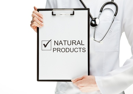 dietology: Doctor advising eating natural products, closeup of doctors hands holding clipboard with marked checkbox and words NATURAL PRODUCTS, healthy eating concept isolated on white