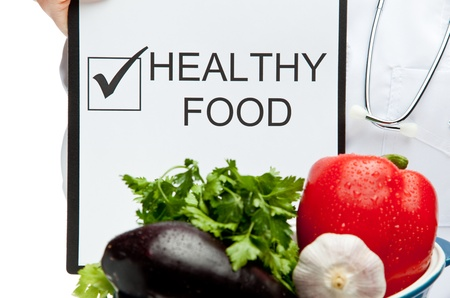 Doctor advising healthy food, closeup of doctor's hands holding clipboard with marked checkbox and words HEALTHY FOOD, and brazier with fresh vegetables, healthy eating concept isolated on white Stock Photo - 13015099