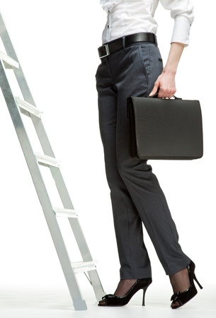 Career ladder: businesswoman starting career; ladder of success concept, white background photo