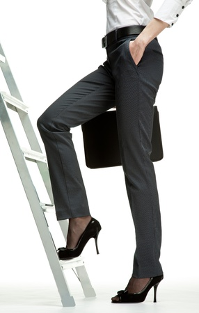 Career ladder: businesswoman starting career promotion; ladder of success concept, white background