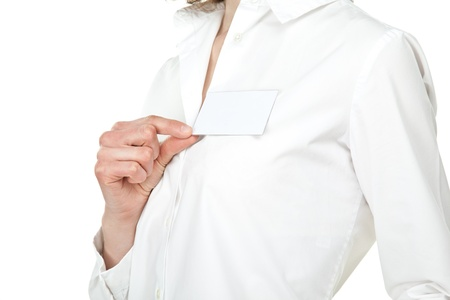 Closeup of young womans hand showing blank name badge; isolated on white photo