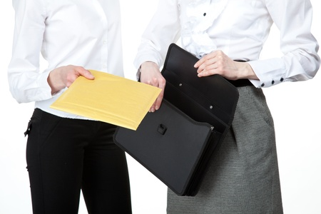 Business people exchanging documents; closeup of businesswomen photo