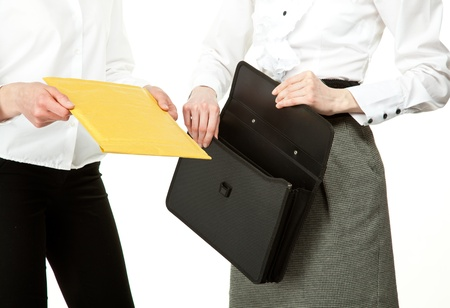 Business people exchanging documents; closeup of businesswomen Stock Photo - 13039160