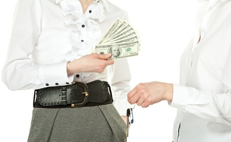 Buying or renting real estate (house, appartment, office); women exchanging keys and money isolated on white photo