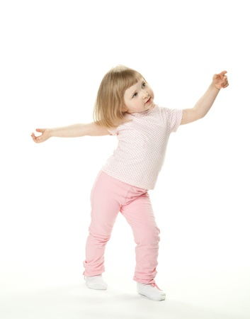 dancing children: Adorable baby girl dancing; little baby girl on white background Stock Photo