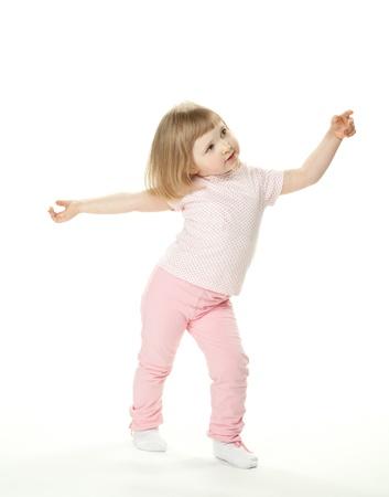 Adorable baby girl dancing; little baby girl on white background Foto de archivo