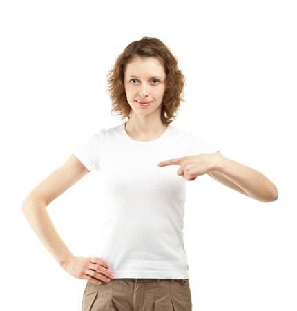 Smiling young woman pointing at herself with index finger (you can write your text on her white t-shirt); isolated on white background Stock Photo - 13147264