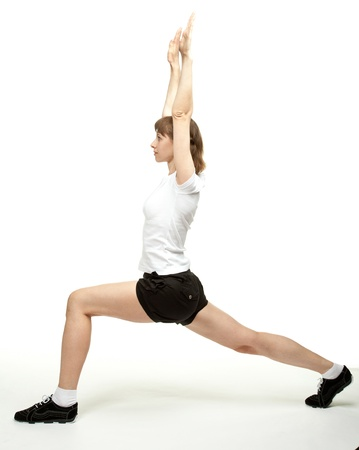 Young woman doing sport exercises; white background photo