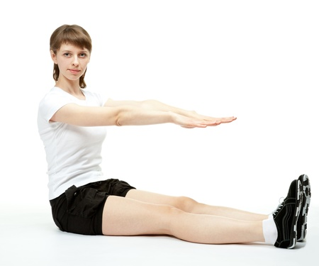 Attractiye young woman doing sport exercises; white background photo