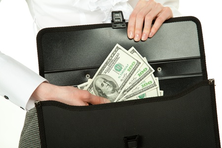 Female hand taking money out of briefcase isolated on white