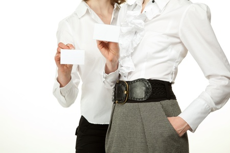 Two women showing blank badges, you can write your text on them; female hands holding badges photo