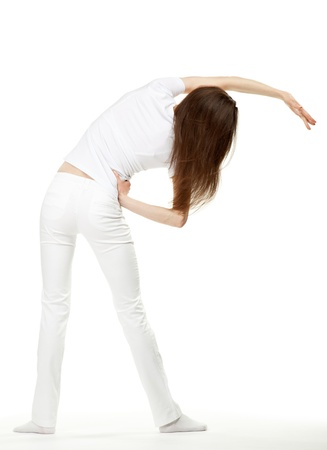 lean back: Slender young woman doing sport exercises; rear view on white background Stock Photo