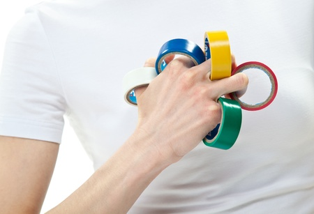 Human hand showing multicolored adhesive/isolating tape on fingers Stock Photo - 13532660