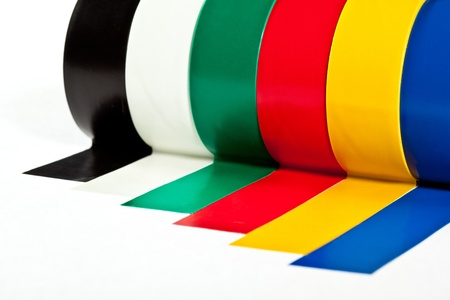 Rolls of insulation adhesive tape; multicolored isolating tape on white background