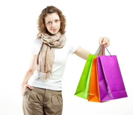 Beautiful girl holding shopping paper bags on white background photo