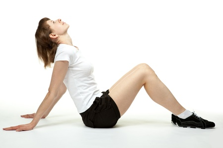 Attractive young woman doing sport exercises on white background photo