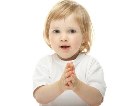 manos aplaudiendo: Bebé lindo que aplaude sus manos aisladas en blanco Foto de archivo