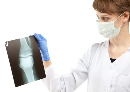 Female doctor examining X-ray isolated on white
