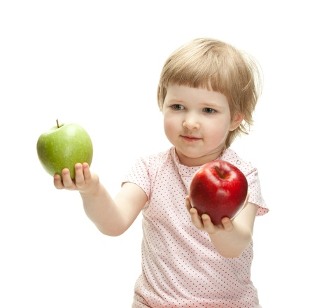 Cute child holding apples isolated on white photo