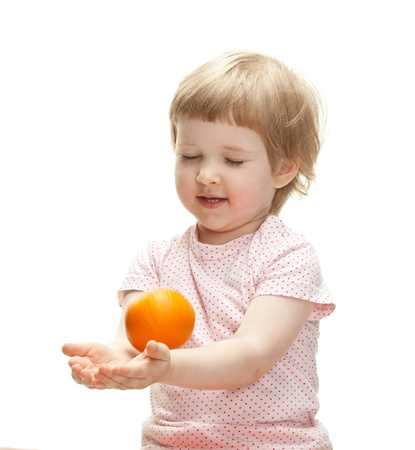 Happy child playing with orange catching it, isolated on white Stock Photo - 13664930
