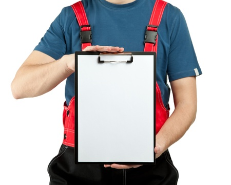 Industrial worker in uniform holding clipboard with blank sheet of paper; you can add your text, copyspace; isolated on white photo