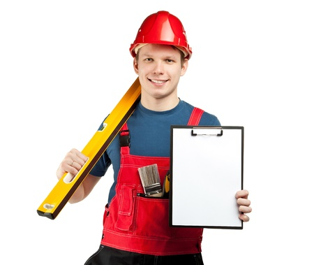 Friendly construction worker in uniform and hardhat holding gauge and clipboard with blank paper - you can add your text or contacts; isolated on white photo