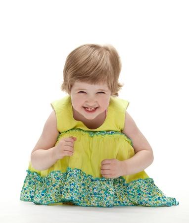 Joyful baby sitting on the floor; white background Stock Photo - 13846606