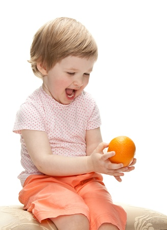 Happy laughing child playing with orange, isolated on white Stock Photo - 13847007
