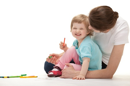 Happy laughing child drawing with her mother; white background photo