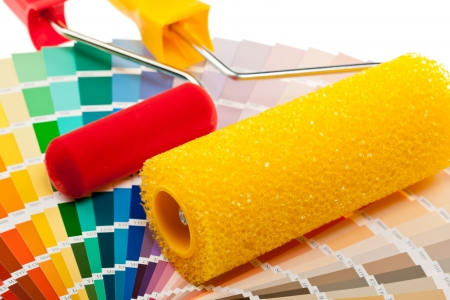 red paint roller: Paint rollers and color samples for interior and exterior decoration works