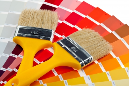 Paintbrushes and color samples for interior and exterior decoration works photo